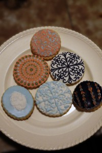 Assorted round cookies in various elegant designs